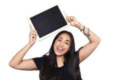 Latin woman holding chalkboard. Stock Photo