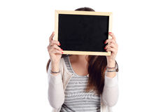 Latin woman holding chalkboard. Portrait of latin woman holding chalkboard. Isolated white background Royalty Free Stock Image