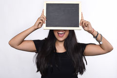 Latin woman holding chalkboard. Portrait of latin woman holding chalkboard.  white background Stock Photos