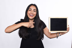 Latin woman holding chalkboard. Portrait of latin woman holding chalkboard.  white background Stock Photography