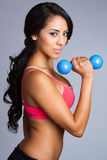 Latin Woman Lifting Weights Stock Photography