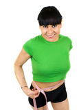 Latin woman with measure tape. Close up of slim stomach with measuring tape around it Royalty Free Stock Images