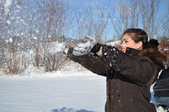 Latin Woman Playing in the Snow stock photography