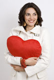 Latin woman with red heart Royalty Free Stock Photos
