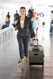 Latin woman running at the airport Stock Photos