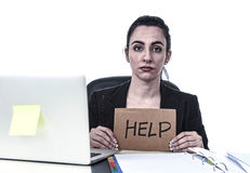 Latin woman showing help sign desperate suffering stress at work while sitting at office laptop. Young attractive latin woman showing help sign desperate Royalty Free Stock Images