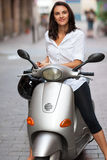 Latin woman sitting on a motorcycle Stock Photos