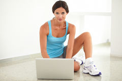 Latin woman sitting and using her computer Stock Photo