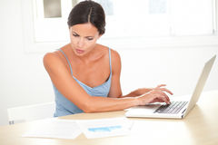 Latin woman studying on her computer Royalty Free Stock Images