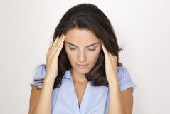 Latin woman suffering from headache Royalty Free Stock Images