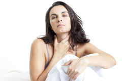 Latin woman suffering from sore throat. Woman suffering from sore throat Royalty Free Stock Images