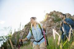 Latin woman trekking with boyfriend Stock Photos
