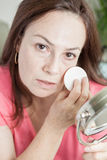 Latin woman using make up Stock Photography