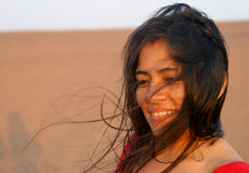 Latin Woman in Wind. Attractive Latin Woman in desert with wind Royalty Free Stock Photography