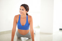 Latin woman in yoga class exercising Stock Photo