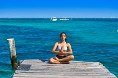 Latin woman yoga relaxing in Caribbean Royalty Free Stock Photography