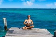 Latin woman yoga relaxing in Caribbean Stock Photography