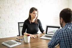 Man and woman working on a project Royalty Free Stock Photography