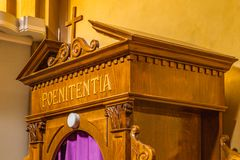 Latin word on a wooden confessional. The Latin word poenitentia meaning repentance Royalty Free Stock Images