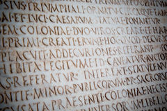 Latin words carved on ancient roman stone, Pisa royalty free stock photo
