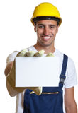 Latin worker showing card Stock Photo