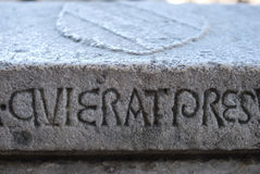 Latin writing, carved into a stone slab Stock Photo