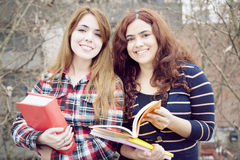 Latin young female student friends Royalty Free Stock Images