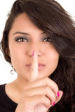 Latin young girl giving the shhh expression Royalty Free Stock Photo