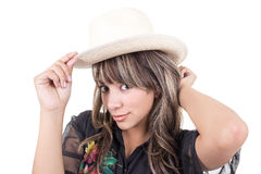 Latin young girl putting straw hat on Royalty Free Stock Photography