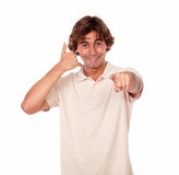 Latin young man gesturing call me sign Stock Image