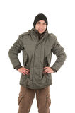 Latin young man wearing green winter coat and a Stock Photography
