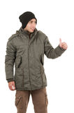Latin young man wearing green winter coat and a Royalty Free Stock Photography