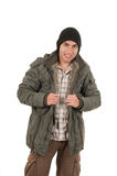 Latin young man wearing green winter coat and a Stock Photos