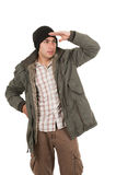 Latin young man wearing green winter coat and a Royalty Free Stock Photos