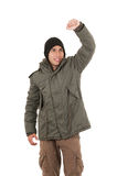 Latin young man wearing green winter coat and a Stock Photo