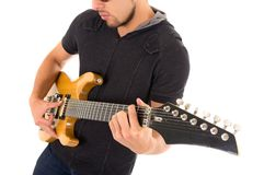 Latin young musician with electric guitar Royalty Free Stock Photos