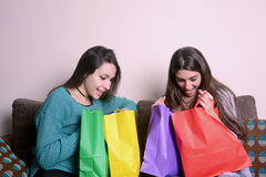 Latin young woman holding shopping bags Stock Photo