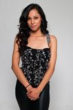 Latina. Pretty young Latina in a black sleeveless top royalty free stock photos
