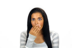 Latina adolescente hermosa dada una sacudida eléctrica o desconcertada Imagen de archivo