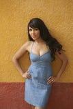 Latina Beauty at Colorful Wall Royalty Free Stock Photos