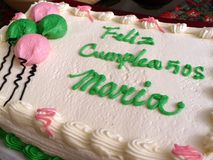 Latina Birthday. Photo of birthday cake which says happy birthday Maria in spanish. Feliz Cumpleanos means happy birthday and Maria is the common name of a royalty free stock photography