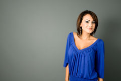 Latina in Blue. A young attractive hispanic woman smiling shoulders Royalty Free Stock Photo