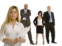 Latina business woman with her colleagues. Young Hispanic woman with her colleagues Stock Image