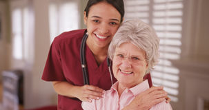 Latina caretaker with senior woman smiling Stock Photography