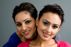 Latina Cousins. Two latinas with beautiful make up smile for the camera Stock Images