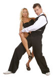 Latina dancers. Beautiful tanned man and woman in black clothes dancing latina Royalty Free Stock Photo
