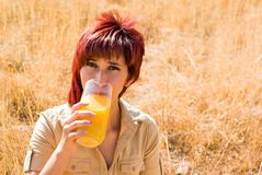 Latina drinks orange juice Stock Photo
