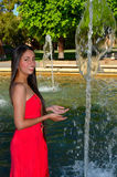 Latina Girl. Lovely latina girl in a water pond Stock Photography