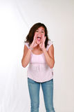 Latina Girl Shouting. Cute latina preteen girl with curly hair Royalty Free Stock Images