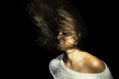 Latina Girl White Sweater Flinging Hair Stock Photo